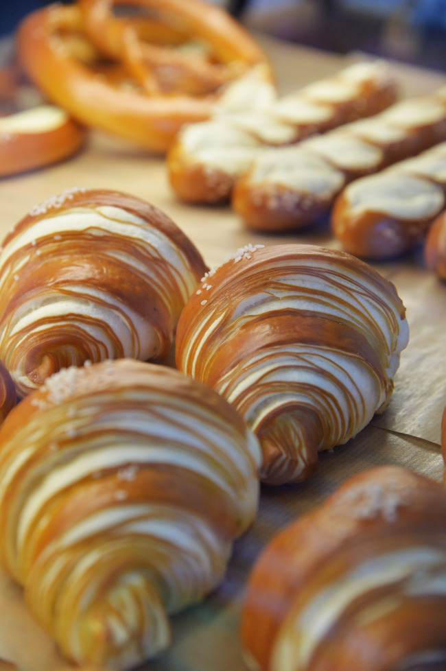 Buttery, flaky and salty pretzel croissants and pretzels at Artisan Bakers' Seorae Village store (Yoon Byung-chan/The Korea Herald)