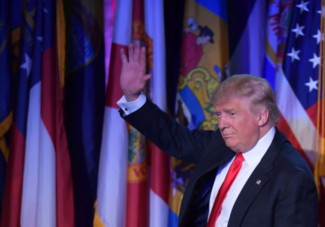 Republican presidential elect Donald Trump waves to supporters during election night at the New York Hilton Midtown in New York on Nov.9. (AFP-Yonhap)