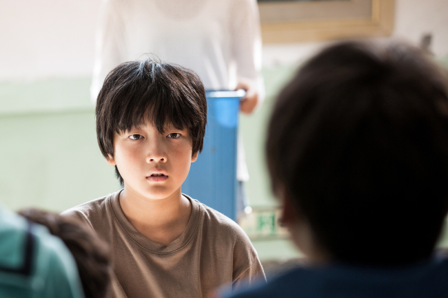 """Child actor Lee Hyo-je, 12, stars in the film """"Vanishing Time: A Boy Who Returned,"""" slated to hit theaters on Nov. 16. (Showbox)"""