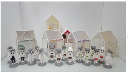 Actual-size character figurines and houses designed via the convergence toy platform Playhouse and printed out using a 3D printer.