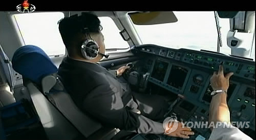 A footage captured from North Korea's Korean Central Television on Dec. 30, 2014, shows North Korean leader Kim Jong-un seated in the cockpit of an airplane.(Yonhap)