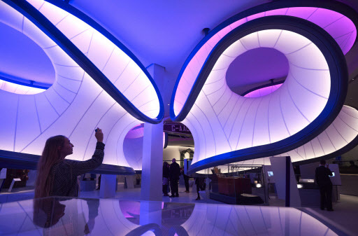 A woman uses a cellphone to photograph a new gallery, Mathematics: The Winton Gallery, inside the Science Museum during a press view in London on Wednesday. (AFP-Yonhap)