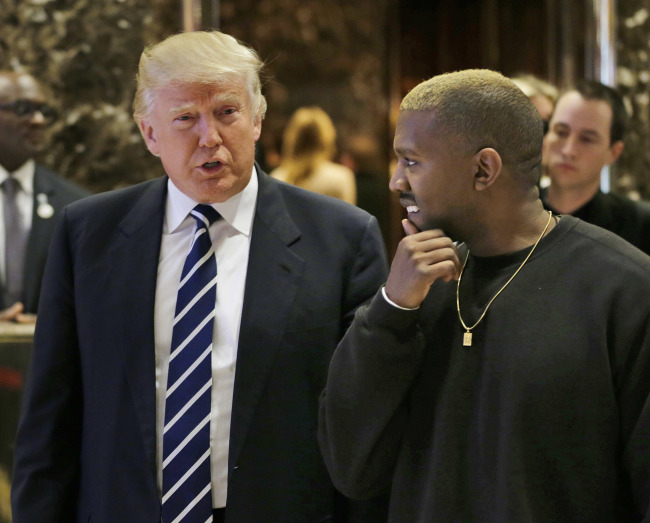President-elect Donald Trump talks with Kanye West in the lobby of Trump Tower in New York, Tuesday. (AP - Yonhap)