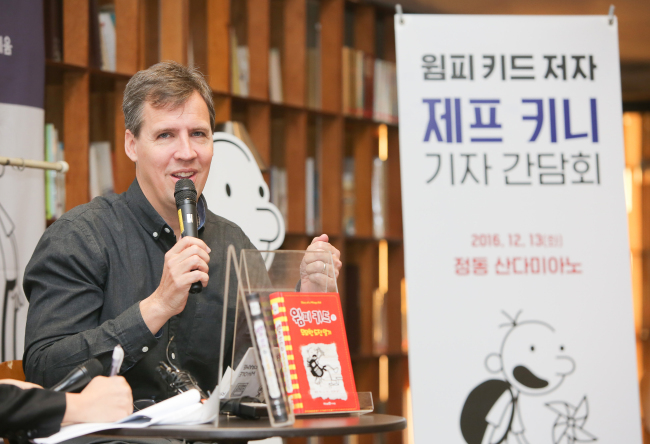 "Jeff Kinney, author of children's classic ""Diary of a Wimpy Kid,"" speaks at a press conference in Seoul on Tuesday. (Access Communications and Consulting)"