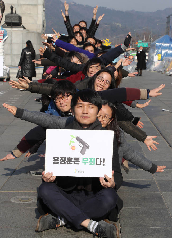 Hong Jeong-hoon, an activist affiliated with the progressive People's Solidarity for Participatory Democracy, holds a performance at Gwanghwamun Square on Dec. 13 after announcing his conscientious objection to the state military service. (Yonhap)