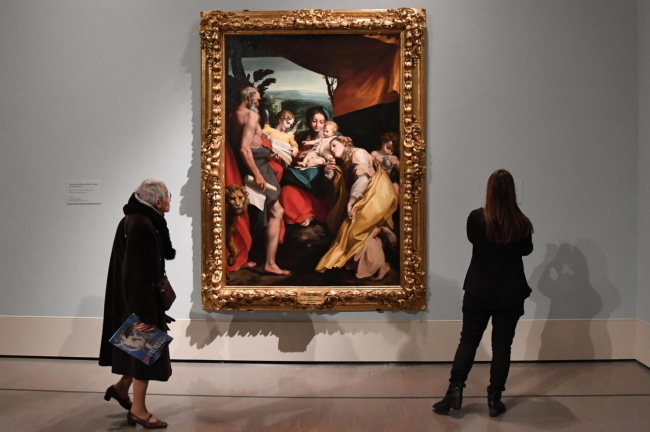 "Visitors view a painting entitled ""Madonna and child, an Angel and St Mary Magdalene and St Jerome (The Day)"" by Federico Barocci on display at the ""Museo Universale: Dal sogno di Napoleone a Canova,"" exhibition at Quirinal Palace in Rome, on Thursday. EPA-Yonhap"