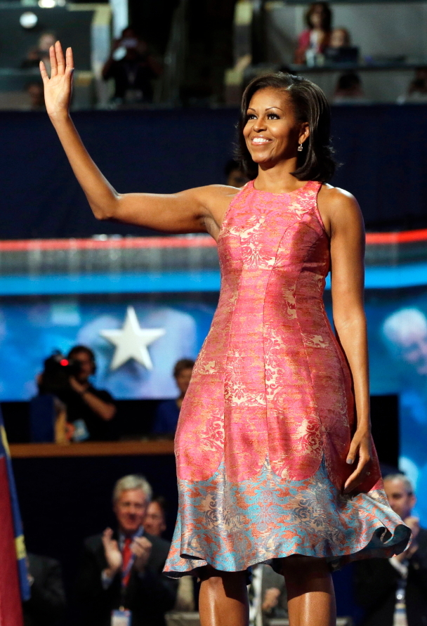 In this Sept. 4, 2012 file photo, first lady Michelle Obama, dressed in a Tracy Reese pink silk jacquard dress, waves to delegates at the Democratic National Convention in Charlotte, North Carolina. (AP-Yonhap)