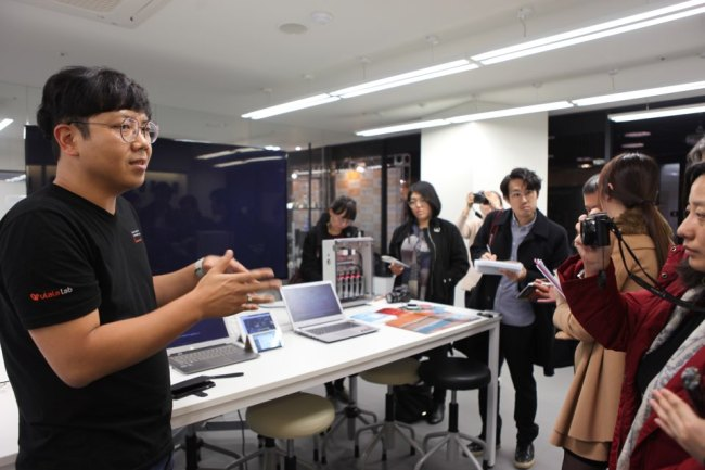 UlalaLab employee Choi Iron Hyuncheol introduces Wimfactory, an IoT platform for smart factory. (Park Ga-young/The Korea Herald)