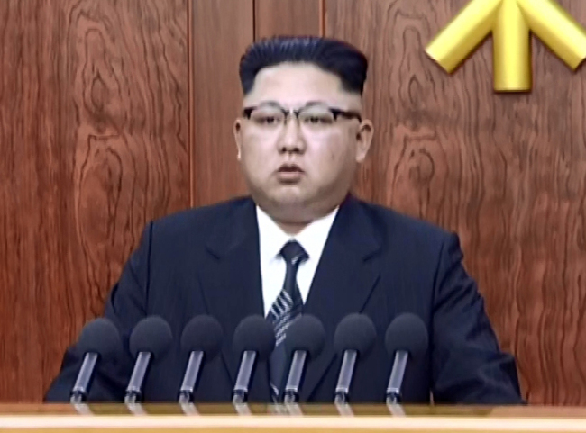 North Korean leader Kim Jong-un delivers a New Year message on Sunday. (Yonhap)