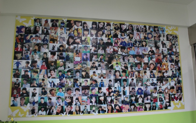 Pictures of the 250 student victims of Danwon High School hang on the staircase inside the relocated Memorial Classroom. (Jo He-rim/The Korea Herald)