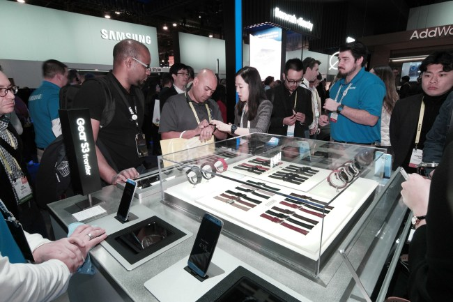 Visitors look and try on the Samsung Gear S3 at the Samsung Electronics booth at the Consumer Electronics Show 2017 in Las Vegas on Saturday. (Samsung Electronics)
