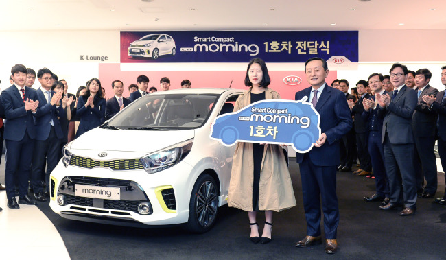 Choi Soo Bin Center The First Customer To Kia Motors All New Morning Compact Car Poses With Company Officials During A Ceremony Celebrating