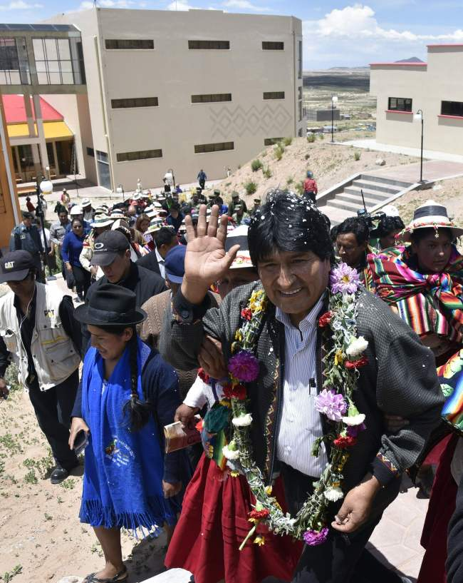 "Bolivian President Evo Morales Ayma (right) waves to the public during the inauguration of the ""Democratic and Cultural Revolution Museum"" in his native Orinoca, Oruro department, western Bolivia on Feb. 2. (AFP)"