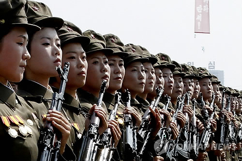 North Korean troops march during a military parade at Kim Il-sung Square to mark the 65th anniversary of the country's founding in Pyongyang on Sept. 9, 2013, in this file photo released by The Associated Press. (Yonhap)