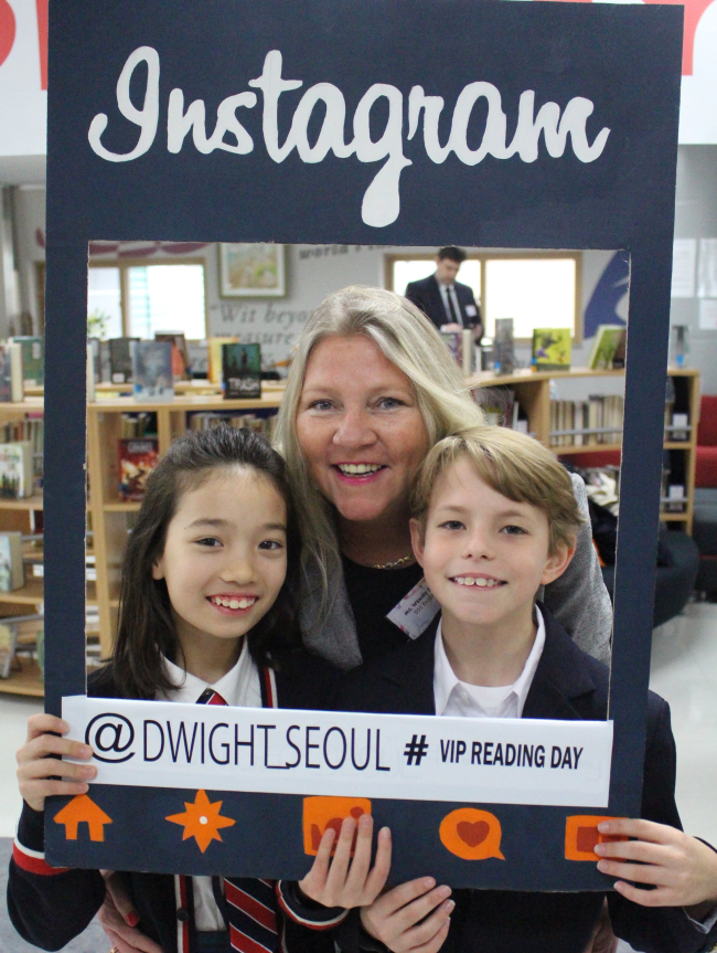 Wendy Seay, an information system officer at the US Embassy in Seoul, poses with two fifth-grade students at Dwight School Seoul. Dwight School Seoul