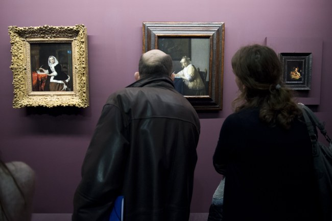 """The artwork entitled """"La Lettre Interrompue"""" (center) by Dutch artist Johannes Vermeer is displayed during the exhibition """"Vermeer and the Masters of the Paintings"""" at the Louvre in Paris on Tuesday. (EPA-Yonhap)"""