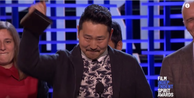 Director Andrew Ahn hoists his trophy at the 2017 Film Independent Spirit Awards on Saturday. (Screen capture from YouTube)