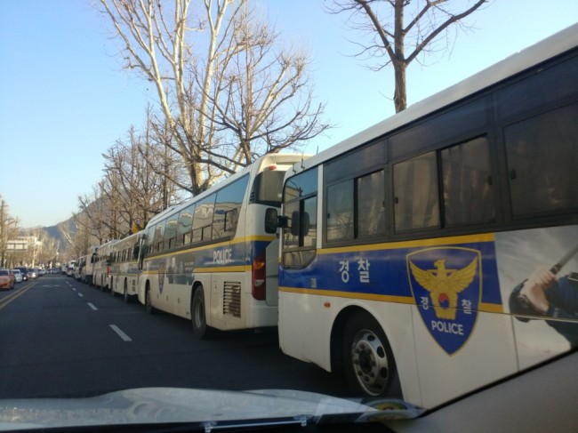 Police buses line up next to the Constitutional Court (The Korea Herald)