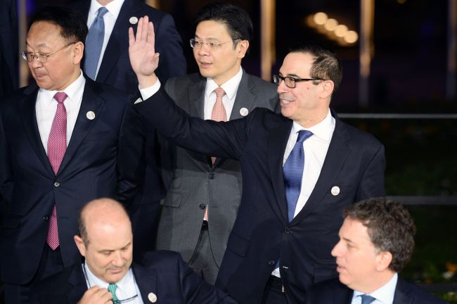 US Secretary of the Treasury Steven Mnuchin (right) waves as he and other participants in the G20 Finance Ministers and Central Bank Governors Meeting pose for the Family photo in Baden-Baden, southern Germany, onFriday.Seenon the left is South Korea's Finance Minister Yoo Il-ho. (AFP)