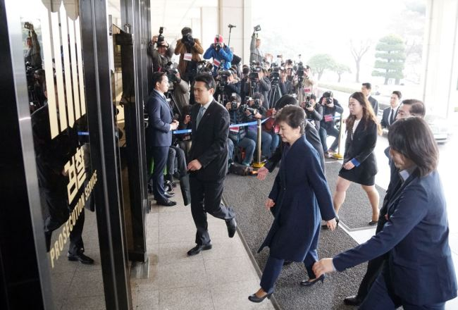 Former President Park Geun-hye heads to prosecution for questioning over corruption scandal on Tuesday. (Yonhap)