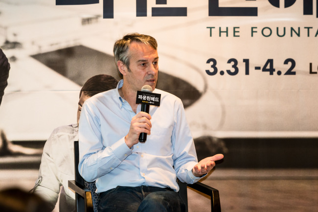 """caption:Theater director Ivo van Hove speaks during a press conference for the upcoming performance of his play """"The Fountainhead,"""" held Thursday at LG Arts Center in Seoul. (LG Arts Center)"""