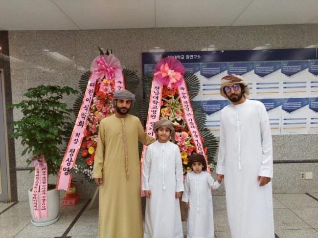 Ali Al Dhahouri (left) poses with family members at Seoul National University Hospital in Korea on Thursday (SNUH)