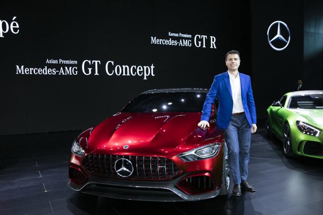 Mercedes-Benz Korea CEO Dimitris Psillakis poses next to the company's new Mercedes-AMG GT concept car. (Yonhap)