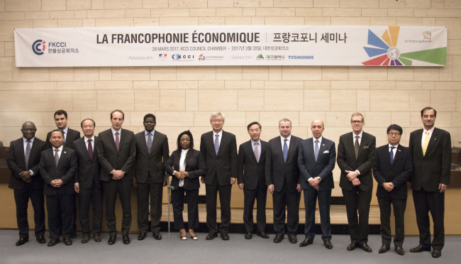 Participants pose for a photo while attending the La Francophonie Economique seminar hosted by the French Korean Chamber of Commerce and Industry on Tuesday. (FKCCI)