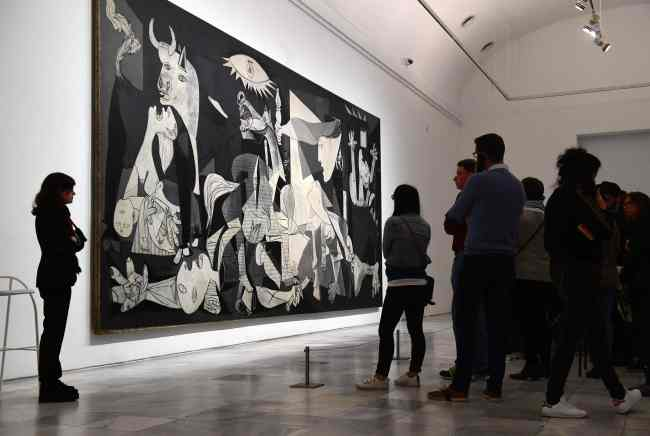 "Visitors look at Spanish artist Pablo Picasso's ""Guernica"" at Reina Sofia museum in Madrid on March 24. AFP-Yonhap"