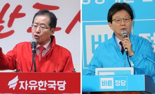 Liberty Korea Party candidate Hong Joon-pyo (L) and Rep. Yoo Seong-min of the Bareun Party (Yonhap)