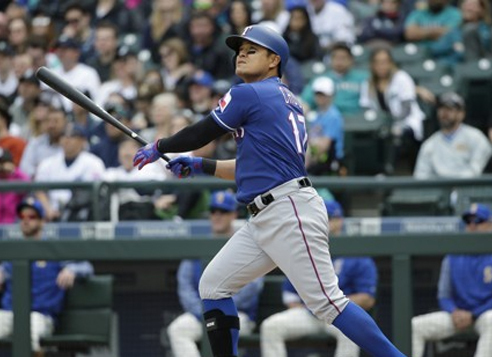 In this Associated Press photo, Choo Shin-soo of the Texas Rangers watches his three-run home run against the Seattle Mariners at Safeco Field in Seattle on April 16, 2017. (Yonhap)