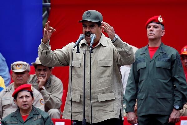 Venezuela's President Nicolas Maduro (center) speaks during a ceremony with militia members at Miraflores Palace in Caracas, Venezuela April 17, 2017. (Reuters)