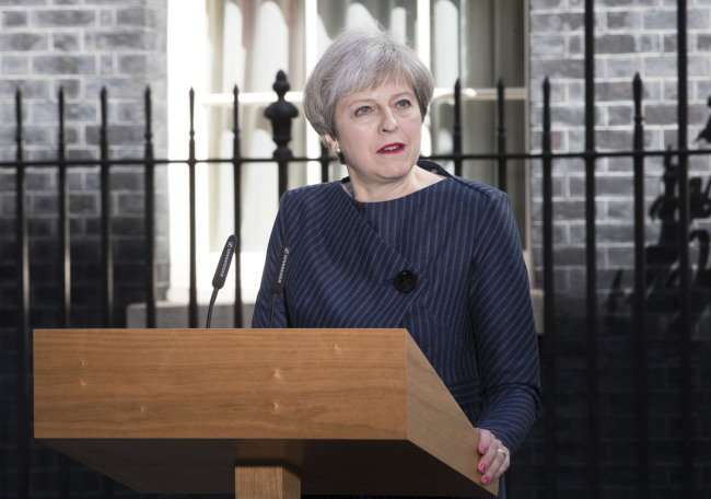 British Prime Minister Theresa May speaks to media as she calls a snap general election in London on Tuesday. Xinhua-Yonhap