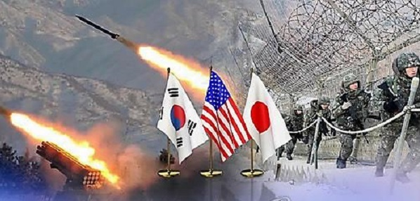 An image representing three-way defense cooperation between South Korea, the US and Japan against North Korea is shown as this file photo provided by Yonhap News TV. (Yonhap)
