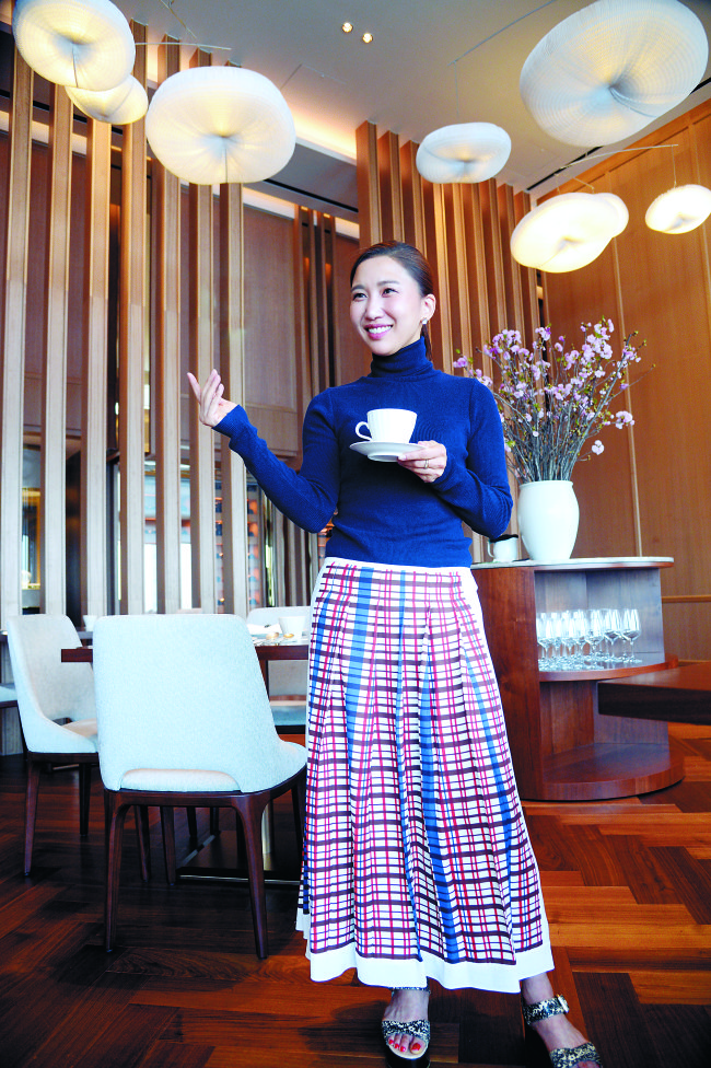 Lucia Cho poses at Bicena on the 81st floor of Lotte World Tower in Seoul on April 21. (Park Hyun-koo/The Korea Herald)