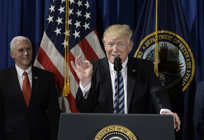 US President Donald Trump (right) speaks before signing an executive order at the Department of Veterans Affairs in Washington on Thursday. (EPA-Yonhap)