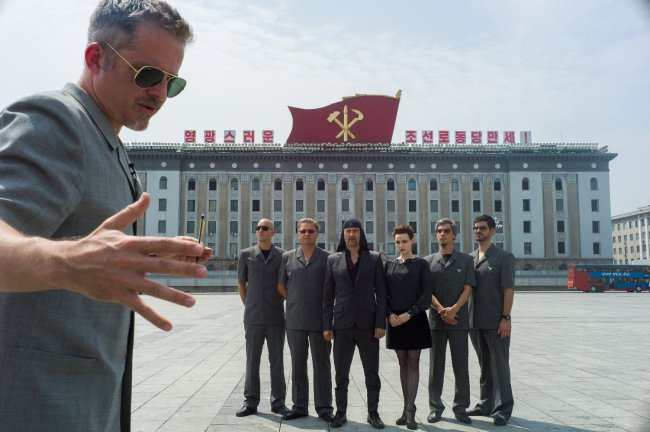 """Morten Traavik (left) directs Laibach during a photo shoot in Pyongyang in a scene from documentary musical """"Liberation Day."""" (JIFF)"""