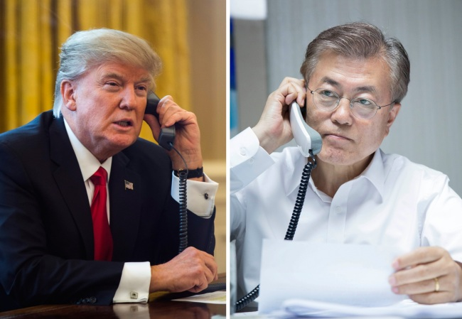 South Korea's President Moon Jae-in (right) receives a call from US counterpart Donald Trump late Wednesday. (Yonhap)