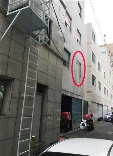 An emergency exit door is not installed without an emergency staircase or ladder. (Yonhap)