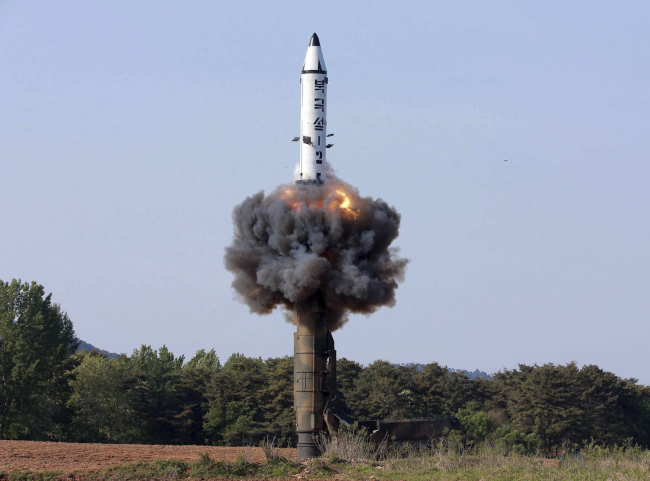 In this undated photo released on May 22 by North Korea`s official Korean Central News Agency, the Pukguksong-2 missile lifts off during a test a day earlier. (AP-Yonhap)