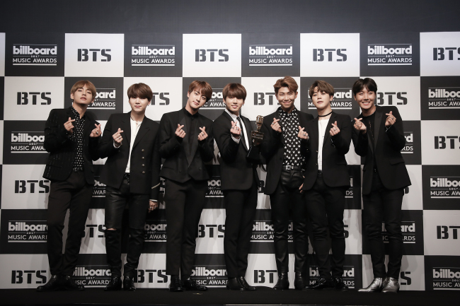 BTS poses for a photo before a press conference at Lotte Hotel Seoul on Monday. (Big hit Entertainment)