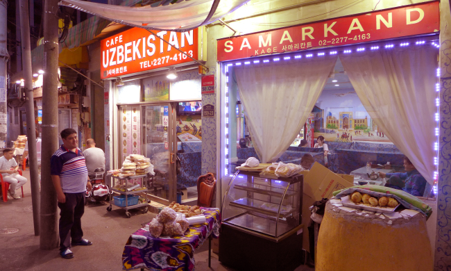 The district near the Dongdaemun History and Culture Park in Seoul is home to Eurasian businesses encompassing eateries, bakeries, supermarkets and shipping outlets. (Joel Lee/The Korea Herald)