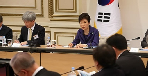 This file photo, taken on Dec. 2, 2014, shows then President Park Geun-hye presiding over the third meeting of the Presidential Committee for Unification Preparation at the presidential office Cheong Wa Dae in Seoul. (Yonhap)