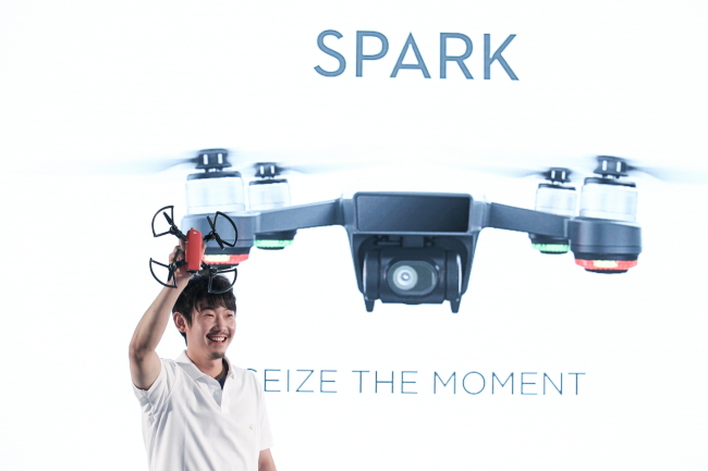 DJI Korea Country Manager Moon Tae-hyun holds the Spark at the DJI Arena in Yongin, Gyeonggi Province Tuesday. (DJI)