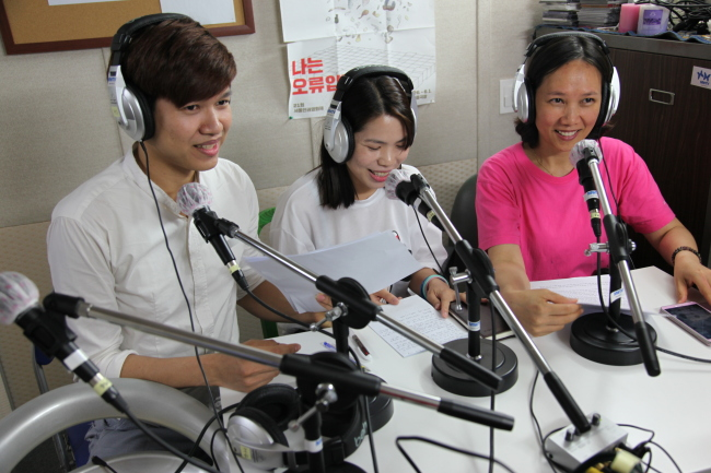 People learn how to present radio broadcasts at the Migrant World TV Academy (MWTV)