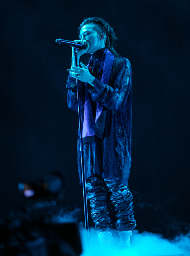 G-Dragon performs during a concert at Sangam World Cup Stadium in Seoul on Saturday. (YG Entertainment)