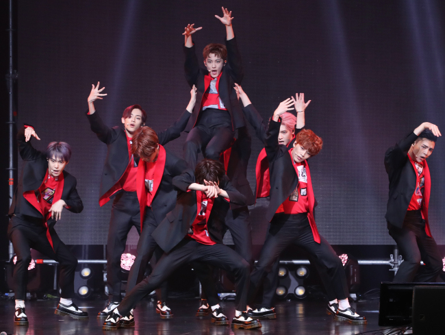 "NCT 127 performs at a press showcase for its third EP, ""Cherry Bomb,"" in Seoul on Wednesday. (Yonhap)"