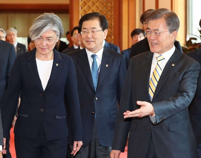 President Moon Jae-in (right) walks with Foreign Minister Kang Kyung-wha after the appointment ceremony at Cheong Wa Dae in Seoul on Sunday. (Yonhap)