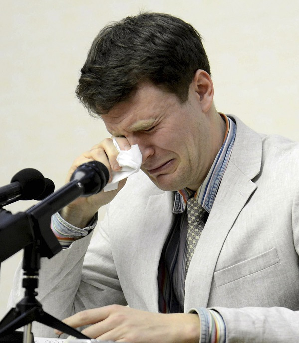 American student Otto Warmbier cries while speaking to reporters in Pyongyang, North Korea. (AP-Yonhap)