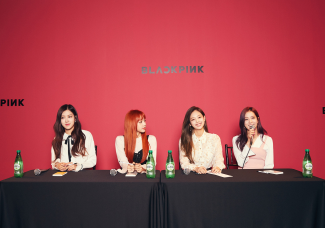 Black Pink speaks during a joint press interview in Seoul on Thursday. (YG Entertainment)